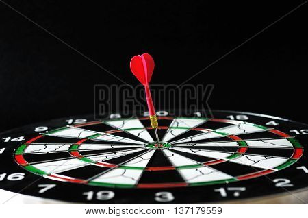 one reed darts on bullseye target board