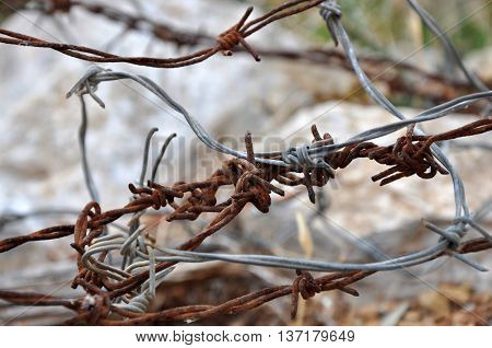 Rusty and grey silver wires somewhere outdoors