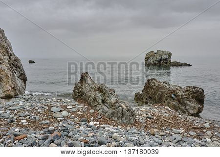 A rocky beach on the coast of the Aegean Sea in Greece