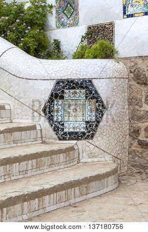 Details of ceramic Gaudi mosaic in Park Guell Barcelona Spain