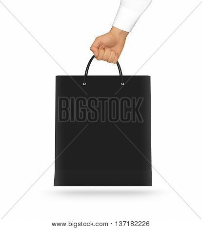 Blank black paper bag mock up holding in hand. Empty plastic package mockup hold in hands isolated on white. Consumer pack ready for logo design or identity presentation. Product packet handle.