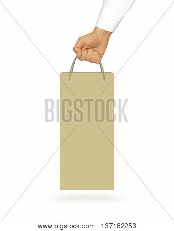Blank yellow wine paper bag mock up holding in hand. Empty plastic package mockup hold in hands isolated on white. Consumer pack ready for logo design or identity presentation. Product packet handle.