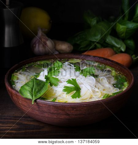 Thai chicken noodle soup dark moody still life