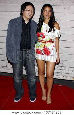 Masi Oka and Olivia Munn at the Maxim's 2008 Hot 100 Party held at the Paramount Studios in Hollywood, USA on May 21, 2008.
