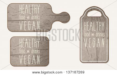 Wooden breadboard with the words healthy food drinks; vegan