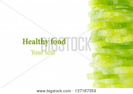 Pile of chopped green pepper rings on a white background. Isolated. Decorative frame of green paprika peppers. Food background. Copy space. Concept art.