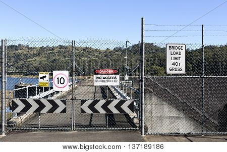 LAKE BAROON, AUSTRALIA - July 3, 2016: View of a shut gate and multiple warning signs on July 3, 2016 in Lake Baroon, Australia