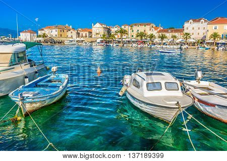 Mediterranean promenade of town Supetar, touristic destination on Island of Brac, Croatia, summer time.