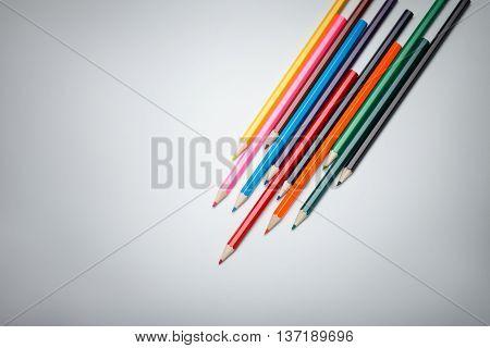 Color pencils palette on vignette background. Focus on pencils heads