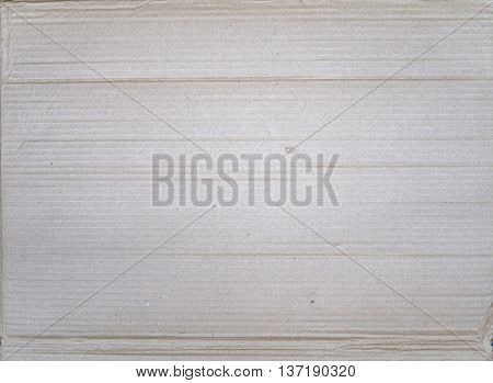 old gray battered corrugated cardboard as texture