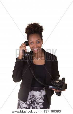 Young business woman using a rotary phone isolated on a white background