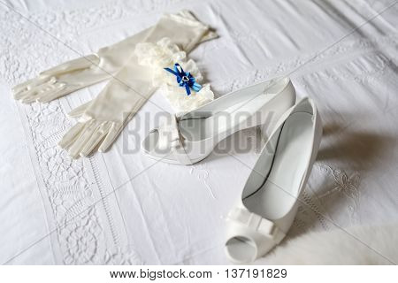 white shoes gloves and garter of the bride