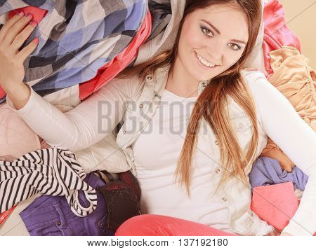 Happy Woman Lying On Sofa In Messy Room At Home.