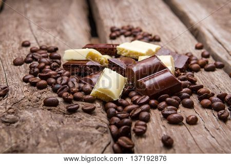 Chocolate and coffee beans. White and brown chocolate. Snack for boosting energy. Product from high quality cocoa.