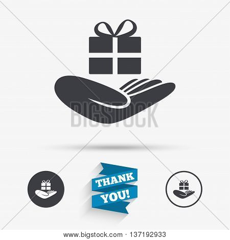 Give a gift sign icon. Hand holds present box with bow. Flat icons. Buttons with icons. Thank you ribbon. Vector