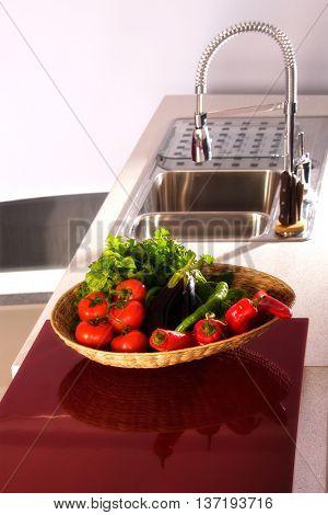 close up shot of vegetables basket in domestic kitchen.
