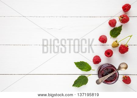 Raspberries Jam And Fresh Berries With Copy Space On White Table. Flat Lay, Top View.