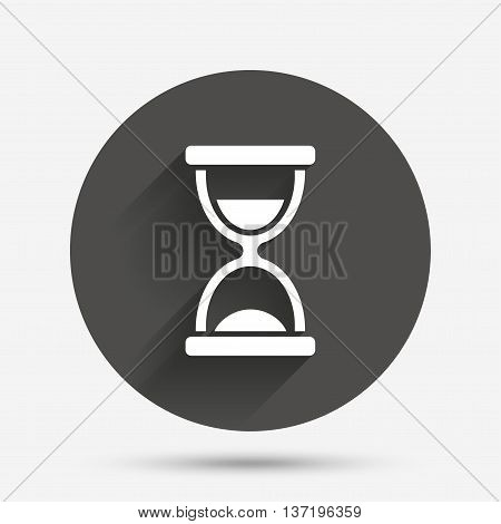 Hourglass sign icon. Sand timer symbol. Circle flat button with shadow. Vector