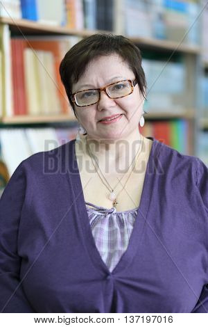 MOSCOW - MAR 20, 2015: Teacher on background of shelves with books. Secondary school number 430 in Moscow operates since 1981, 5 school gymnasium classes, one in each parallels from 5 to 9 classes