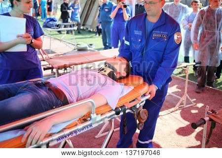 MOSCOW - APR 28, 2015: Transporting the injured man on the trolley during a training exercise at a field hospital on the Burevestnik stadium