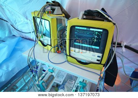 MOSCOW - APR 28, 2015: Bedside monitor with enabled screen in a modular tent of the field hospital