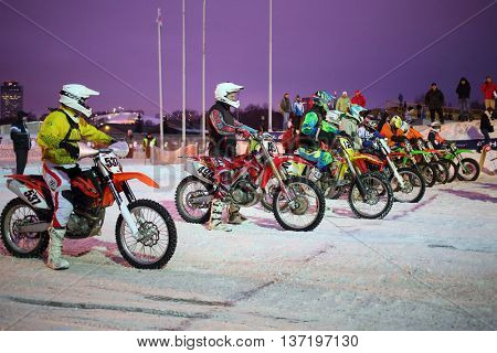 MOSCOW - FEB 14, 2015: Participants Winter Cup motocross on motorcycle in Krylatskoye in the evening