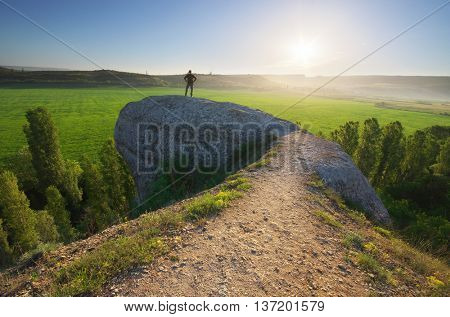 Man in mountain. Landscape composition.