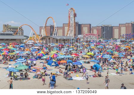 NEW YORK, JULY 4, 2016: Crowded beach in Coney Island - people enjoy beach time waiting for 4th July fireworks display