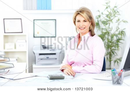 Pretty business woman working at office