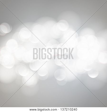 Vector bokeh background. Festive defocused white lights. Abstract blurred illustration.