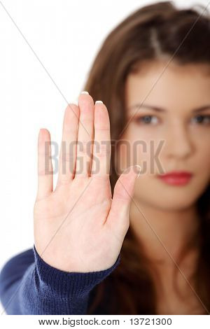 Hold on, Stop gesture showed by young teen woman hand. Isolated on white