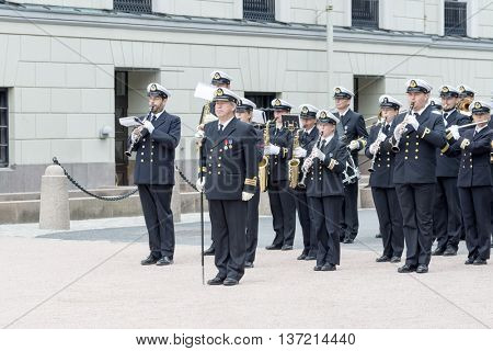 OSLO, NORWAY - JULY 1: A military band accompanying the change of guard of honor in front of the Royal Palace on July 1, 2016 in Oslo, Norway. This daily ceremony is a big tourist attraction.