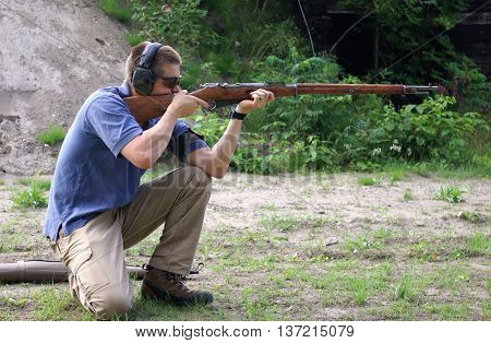 Firing a Mocin on the range in the kneeling