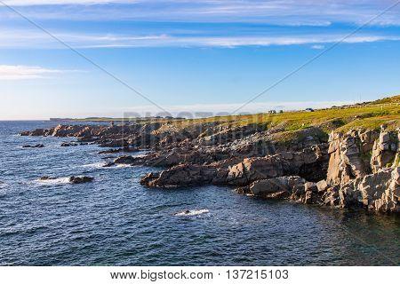 Rocky coastline and blue skies near Cape Bonavista Newfoundland