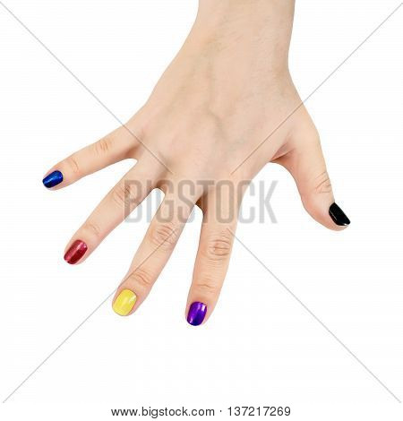 The nails on the fingers of a woman's hand painted in blue red yellow purple and black lacquer