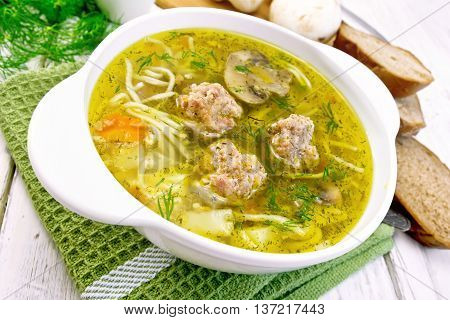 Soup With Meatballs And Noodles In Bowl On Green Napkin