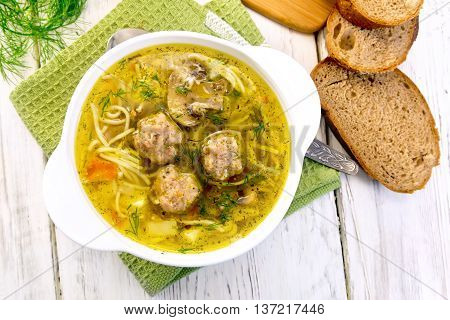 Soup With Meatballs And Noodles In Bowl On Napkin Top
