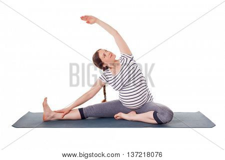 Pregnancy yoga exercise - pregnant woman doing asana Parivrtta janu sirsasana head to knee pose  isolated on white background