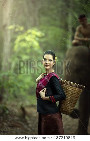 Mahout woman in traditional dress in the wildlife