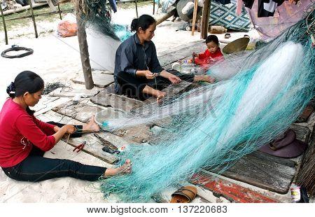 QUANG BINH, Vietnam, June 14, 2016 group of fishermen, sea Quang Binh, Vietnam, sat knitting fishing nets