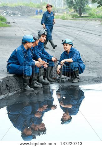 Quang Ninh, Vietnam, May 19, 2016 a group of workers Mao Khe coal mine, Quang Ninh province, Vietnam, minute breaks, shift change