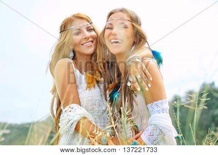 Two beautiful smilling girls. Boho style portrait