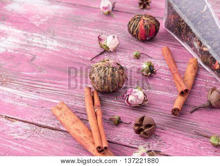 dry tea leaves cinnamon on wooden background