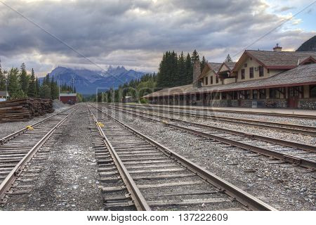 Railway tracks run past the historic Banff Train Station - Banff Alberta Canada