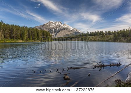Lake With Mountains And Boreal Forest In Background - Alberta, Canada