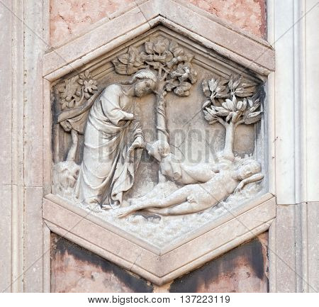 FLORENCE, ITALY - JUNE 05: Creation of Eve by Andrea Pisano, Relief on Giotto Campanile of Cattedrale di Santa Maria del Fiore (Cathedral of Saint Mary of the Flower), Florence, Italy on June 05, 2015