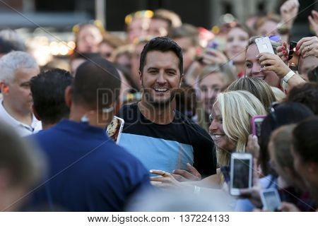 NEW YORK-AUG 7: Country music singer Luke Bryan interacts with the crowd during ABC's Good Morning America Summer Concert Series at Rumsey Playfield on August 7, 2015 in New York City.