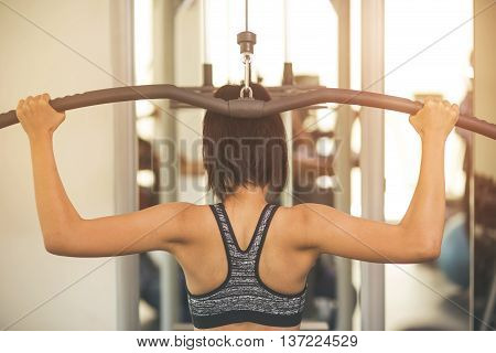 fitness sport training gym and lifestyle concept - group of women excercising with bars in gym