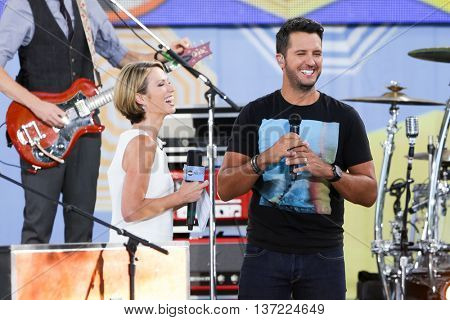 NEW YORK-AUG 7: Country music singer Luke Bryan (R) and journalist Amy Robach onstage at ABC's Good Morning America Summer Concert Series at Rumsey Playfield on August 7, 2015 in New York City.