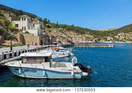 Sevastopol, Russia - June 09, 2016: Yachts and boats in the Balaclava Bay. Former submarine base.